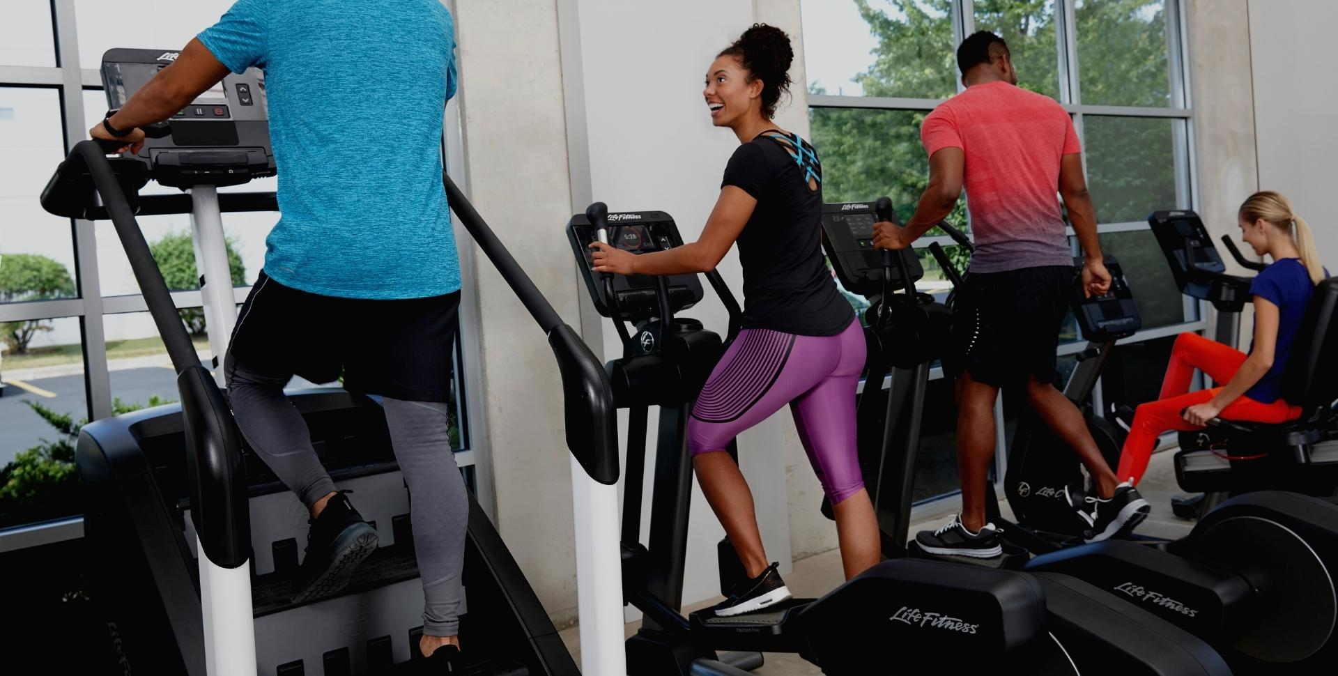 People working out on stair climbers and ellipticals at the fitness 19 midland park new jersey gym